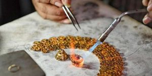 Image That Shows A WOman Doing Crafting Work in Jewellery Workshop.