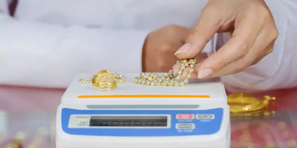 Digital Scales of Weighing Gold Necklace On Store.