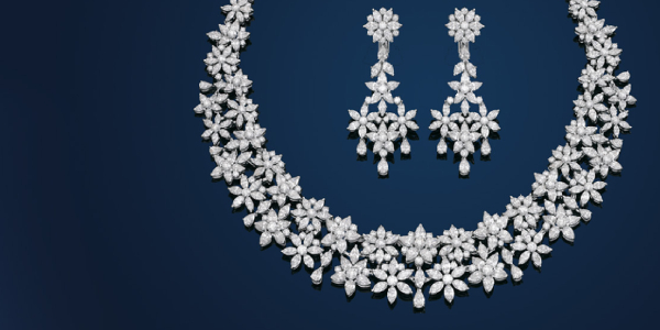 An Elegant Diamond Necklace Isolated In Black Background.
