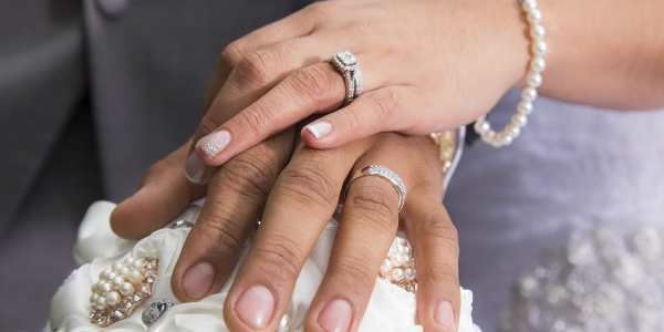 Woman Holding Her Boy Friend's Hand Wearing Elegant Diamond Ring.
